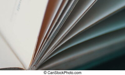 Turning the pages of an old book close-up.Book pages...