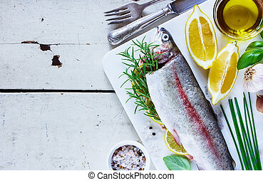 Raw rainbow trout - Close up of rustic white wooden table...