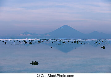 The view of the volcano Agung from Gili Trawangan in the...