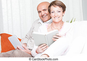 Loving happy couple relaxing reading at home - Loving happy...
