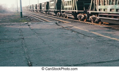 Freight train rides on the railroad - Train with containers...
