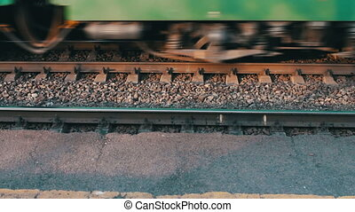 Wheels of the train moving along the rails closeup.Train...
