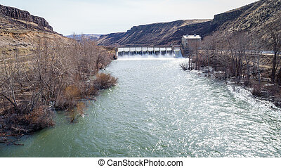 View upstream on the Boise river reveling a Diversion Dam -...