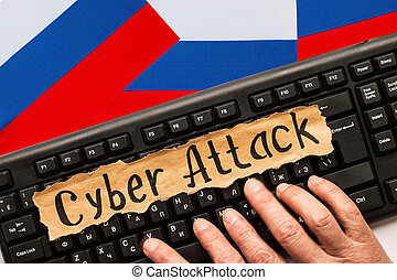 CYBER ATTACK inscription on torn paper sheet. Russia hacking...