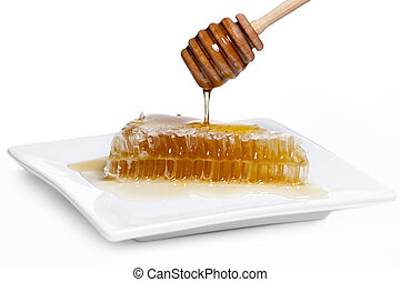 Honeycomb with Wooden Drizzler - Wooden drizzler dripping...