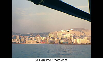 airplane taking off in Hong Kong skyline, Victoria Harbour...