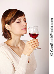 Young woman tasting pink wine
