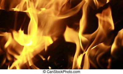 Burning logs, closeup, loopable.