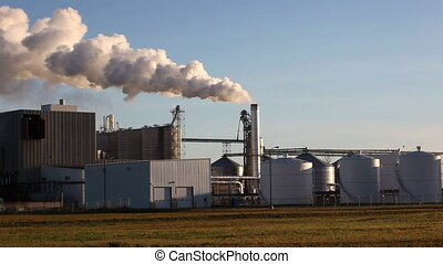 Working Refinery Factory with Emission coming out of...