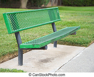 Shallow focus green bence - Green metal bench with shallow...