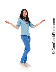 full body picture of a young casual woman welcoming you , on...