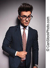 suspicious young business man wearing glasses