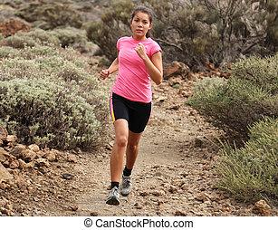 Woman running. Woman trail running outdoors on dirt single...