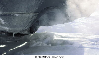 Car pipe puffs out exhaust gas clouds. Smoke clouds coming...