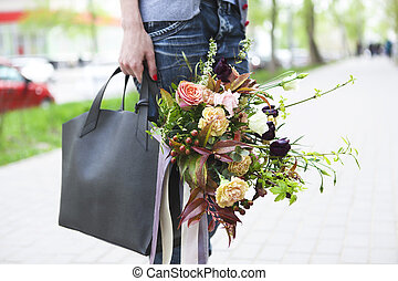 Young beautiful happy woman walking on the street with bag...