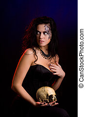 Witch - Young beautiful demonic female creature holding...