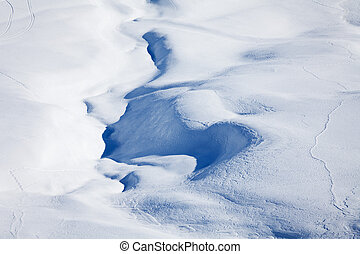 Winter mountains cowered with curving ski traces - Top view...