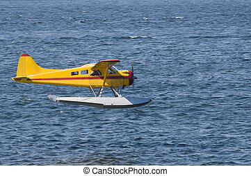 Seaplane coming in to land - single-engined Seaplane coming...