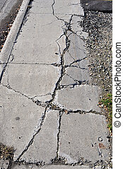 Cracked Sidewalk in Urban Area