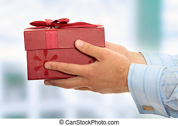 Gift box - Business man offering a gift