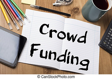 Crowd Funding - Note Pad With Text On Wooden Table - with...