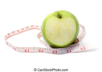 Measuring tape and green apple on white background