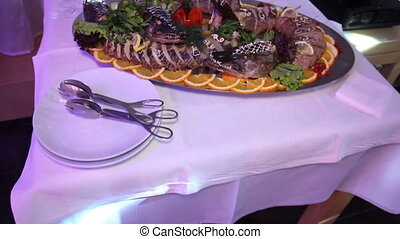 Stuffed pike at served table in restaurant - Chopped stuffed...