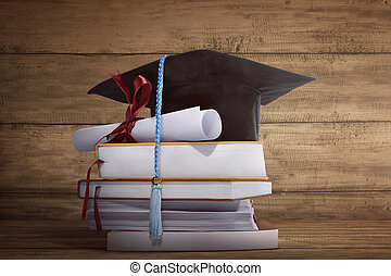 Graduation cap with graduation paper on a stack of book