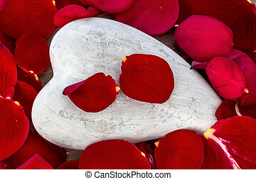 red roses with heart. love for valentine's day - on a stone...