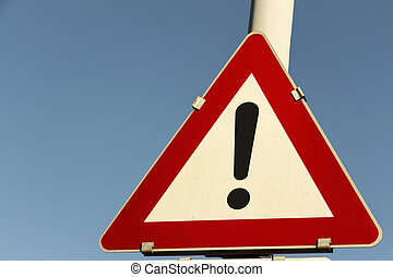 particular risk - a traffic sign that warns of specific...