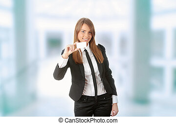 Beautiful young business woman with blank business card...