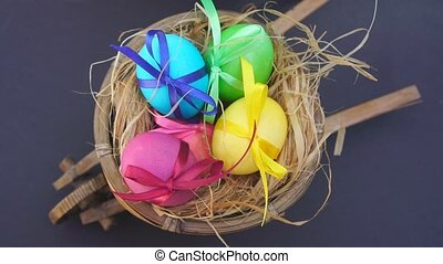 colored eggs in the cart, they put a straw hat