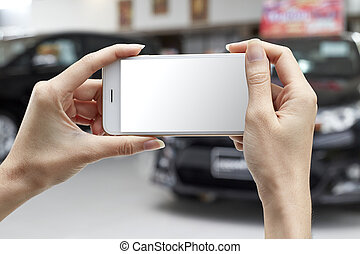 woman with smart phone - woman taking a photo with smart...
