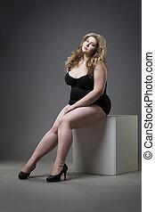 Young beautiful blonde plus size model in shapewear, xxl...