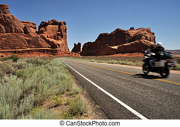 Motorcyclist entering Arches National Park