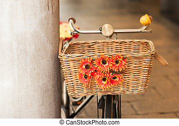 Wicker basket with flowers. - Wicker basket of a bicycle...