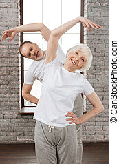 Vertical photo of happy couple while doing sport