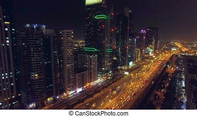 Flight in the night city. Dubai, UAE