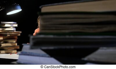Girl goes through a lot of books and can not find the desired information. Black background