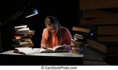 Girl goes through the book and find the right information....
