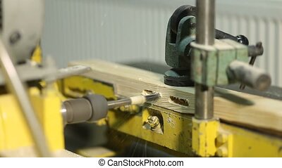 Electric bench drill machine drilling wooden board - Closeup...
