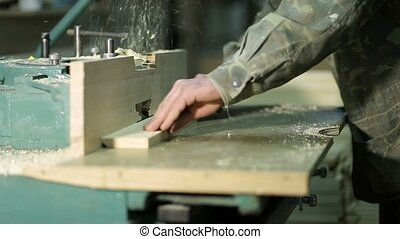 Carpepnter's hands working on electric cutter - Carpenter's...