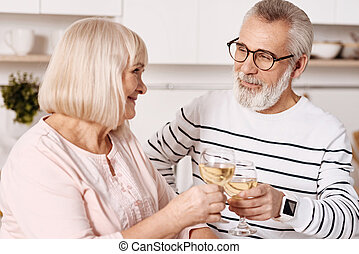 Pleasant couple of pensioners enjoying weekend at home -...
