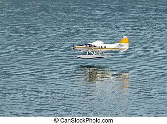Seaplane landing - single engined seaplane coming into land...