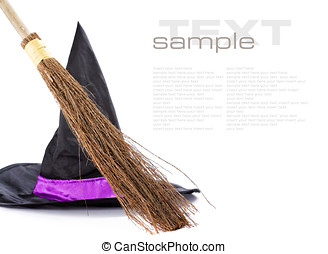 Witch broomstick and hat isolated on white background with...