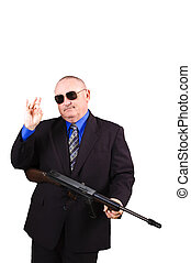 Federal agent with sub-machine gun isoalted over white