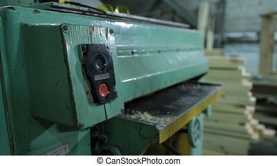 Carpenters planing board with planing machine - Carpenters...