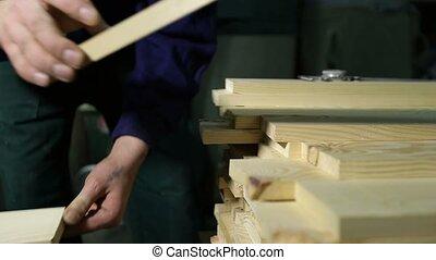 Carpenter working with electric planer machine - Closeup...