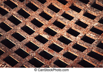 iron grid to sewerage - background rusty iron grid to...