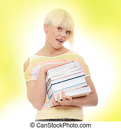 Student - Young caucasian woman (student) with books